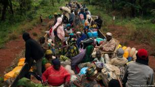 Internally displaced persons (IDPs) take a break on an armed African Union convoy in CAR