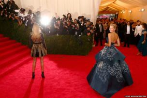 Models Rosie Huntington-Whiteley (left) and Karolina Kurkova pose for photographers