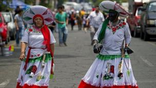 Women commemorate the anniversary of Mexico's victory over France in the Battle of Puebla in 1862, at Penon de los Banos neighbourhood in Mexico City