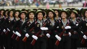 Women dressed as female Vietcong soldiers
