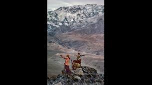 Mujahedeen stand atop a mountain, Hindu Kush, 1984