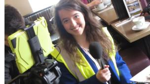 Female School Reporter in high vis vest