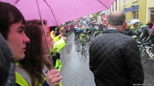 Two School Reporters watch the road cycle race