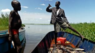 A man and boy from the Mundari tribe are pictured with their catch in Terekeka