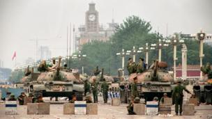 People's Liberation Army tanks guard Chang'an Avenue, leading to Tiananmen Square, 6 June 1989