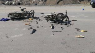 Damaged motorcycles are seen on the road near a Formosa steel mill in Ha Tinh province on 15 May, 2014