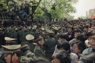 Students demonstrators scuffle with police while trying to reach Tiananmen Square on 27 April 1989
