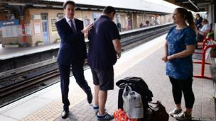 Labour leader Ed Miliband meets passengers on Warrington Bank Quay station