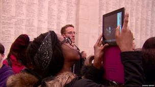 School Reporters Brithany and Charlotte taking photo at Menin Gate ceremony