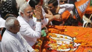 Narendra Modi (2-L) with his supporters in Varanasi on April 24, 2014