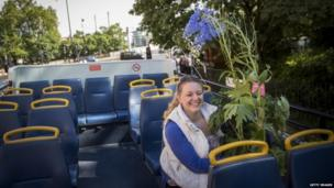 Jayne Squirrell from Canterbury rides on the top deck of an open top bus