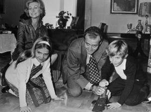 A file photo taken in February 1976 shows King Juan Carlos of Spain and his wife Queen Sophia of Greece, playing with their children Crown Prince Felipe, 8, and daughter Elena, 12, in the Zarzuela Palace in Madrid