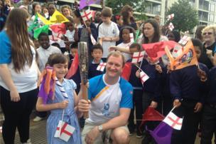 Commonwealth gold medal-winning swimmer Adam Ruckwood with schoolchildren