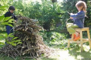 Children prepare a bonfire