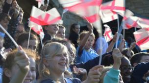 Children waving England flags at Tonbridge Castle