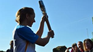 Lizzy Yarnold with the baton at Tonbridge Castle