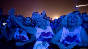 Spectators watch the Rolling Stones concert in Hayarkon Park in Tel Aviv, Israel