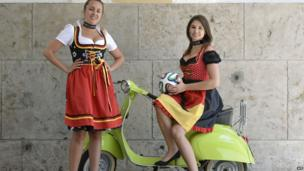 Models in traditional Bavarian dirndl dresses of the World Cup collection 2014 designed by dirndl outfitter Angermaier in Munich, southern Germany