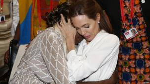 Angelina Jolie hugs Neema Namadamu of the Democratic Republic of Congo a the End Sexual Violence in Conflict summit in London