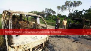 Wreckages of burnt cars are seen along main road to Lamu from Mpeketoni after unidentified gunmen attacked coastal Kenyan town