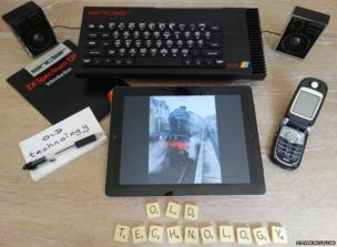 Computer, mobile phone and Scrabble letters