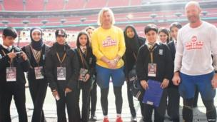 The School Reporters line up with the former footballers