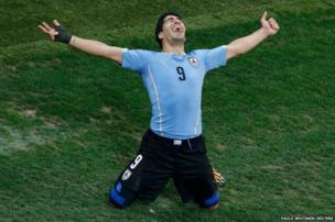 Uruguay's Luis Suarez celebrates scoring his team's second goal against England