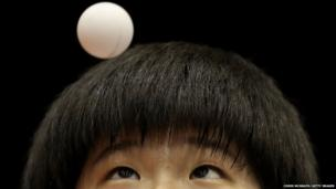 Lee Dasom of Korea serves against Hitomi Sato of Japan