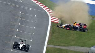 Red Bull Racing's German driver Sebastian Vettel (right) slides off the track in the last turn during the first free practice at the Austrian Formula One Grand Prix