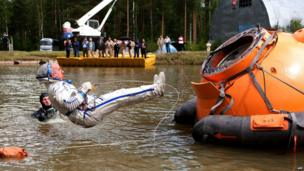 US astronaut Jeffrey Williams takes part in a water landing simulation