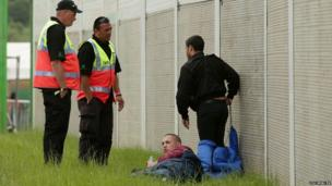 Security guards speak to a couple of festival goers