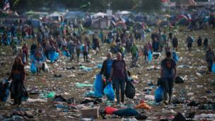 Litter pickers clear the rubbish at Glastonbury