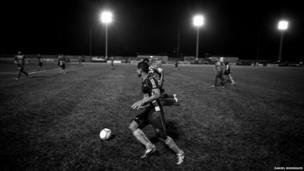 Members of the Gaviao Kyikateje Football Club play a match