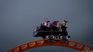People ride the Thunderbolt roller coaster at Coney Island