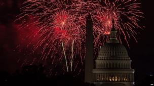 Fireworks explode over the US Capitol and the Washington Monument during Independence Day celebrations in Washington. 4 July 2014