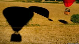 A hot air balloon and shadows