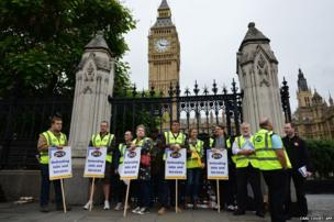 Members of the Public and Commercial Services Union on a picket line outside the House of Commons in central London