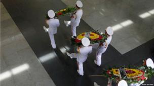 Honour guards carry wreaths during a joint funeral for the 18 military servicemen at the National Funeral House in Hanoi