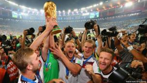 Benedikt Hoewedes of Germany raises the World Cup