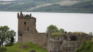 Ruined castle on shore of large body of water