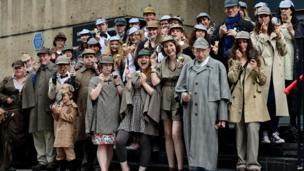 People dressed as Sherlock Holmes character