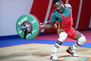 Rasaq Tanimowo, of Nigeria, competes in the men's 56Kg Group B snatch weightlifting at the SECC
