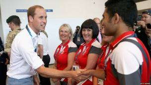 Prince William chats to staff