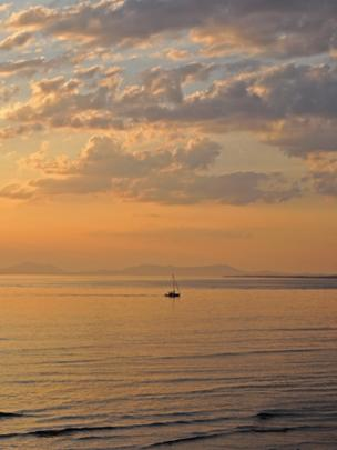 Sunset seen from Fairbourne beach, Gwynedd