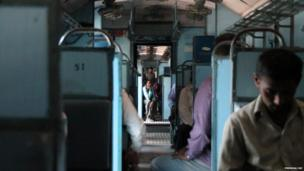 Commuters on a train in Bangalore, India