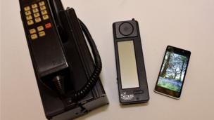 The IBM Simon next to a modern smartphone