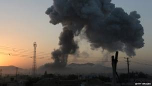 Smoke rises from the site of a suicide attack in Ghazni on 4 September 2014.