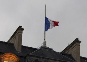 The French flag flies at half-mast over the Elysee Palace in Paris, 8 January