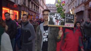 A man holds a placard at the unity rally in Paris, 11 January 2015