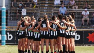 players stand for a minutes silence in tribute to the Christchurch Mosque terror attack during the AFLW Rd 7 match between Collingwood and Brisbane at Victoria Park